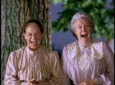 Marilla Cuthbert and Rachel Lynde clearly in a fit of laughter over one of Anne's latest exploits.