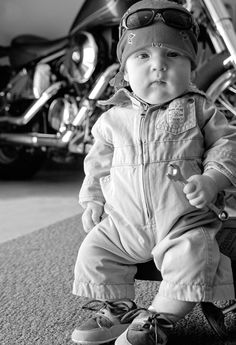 Baby Mechanic. Maybe put a jeep or a Dozer behind him so he looks more like a mini version of Joey