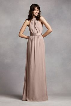 Go for a romantic look in long and flowy crinkle chiffon sheath dress! Halter bodice with a belted waist that features a back streamer for added drama. Fully lined. Back zip. Imported polyester. Dry clean only.