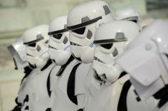 """Members of the 501st Legion who are dressed as stormtroopers line up. """"Star Wars"""" costumes can be expensive."""