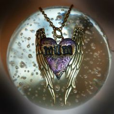 Engraved bronze-tone angel wing pndant with a hand crafted polymer clay heart embossed with the word 'mum', in shimmering shades of gold and lilac. Size - x On a bronze-tone chain - length - With a small wing at the end o. Old Jewelry, Jewelry Making, Jewellery, Shades Of Gold, Wire Wrapped Jewelry, Vintage Watches, Lilac, Polymer Clay, Bronze