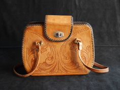 Hey, I found this really awesome Etsy listing at https://www.etsy.com/il-en/listing/256129064/vintage-tooled-leather-handbag-purse