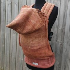 Custom wrap conversion made from a Warped Wattle Weaving Grounding which had beautiful subtle earthy colours. This carrier is a toddler size with petite shoulder and waist straps and a cute pixie hood. #babywearing #babycarrier #pixiehood #handwoven