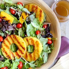 Grilled Tropical Summer Salad Recipe Salads with pineapple, mango, salad greens, cherry tomatoes, balsamic vinaigrette salad dressing, macadamia nuts