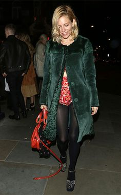 Sienna Miller arriving at Love Magazine's Christmas party in London, England on December 18, 2015, wearing a Chloe Paraty Orange Fizz Bag http://api.shopstyle.com/action/apiVisitRetailer?id=498486681&pid=uid7729-3100527-84. #style #celebstyle