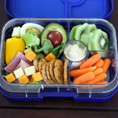 ️Yumbox lunch today in Myrtille Blue Panino. Featuring: baby carrots and hummus dip, sliced kiwi, rice and seaweed crackers, half of small avocado (spoon on a side), baby tomato, cubed cheese, small yellow pepper, an egg, ham slices and lettuce. #Yumbox #packedlunch #bentobox #bentokids #healthylunch #healthyeating #eattherainbow #eatincolor #lunch #weightwatchers #portioncontrol #fit #glutenfree #health #yum #gourmet #color