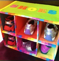 Kids shoe rack  out of a carboard box and decorated with  foam sheets and strips