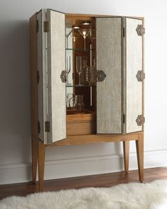 A cabinet in tall legs. A very feminine and seductive cabinet design with tall legs! The Kilt Cabinet, with its geometric design in solid Canaletta Modern Bar Cabinet, Modern Cabinets, Bar Cabinets, Luxury Furniture, Furniture Design, Furniture Decor, Armoires Diy, Bookcase Bar, Traditional Bookcases