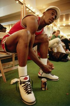 Michael Jordan lacing up his Nike Air Jordan II