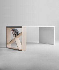 Design: Jean Francois Gomrée, 2004 J-Table è caratterizzato da una gamba che gioca con linee ortogonali asimmetriche e che può essere utilizzata come libreria. Ricco di personalità, pur nel suo rigore formale, questo tavolo risponde ad esigenze di spazio diverse tra loro, in situazioni domestiche o di lavoro. Download