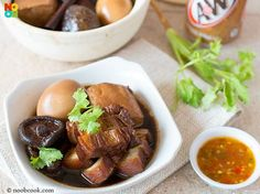 "Root Beer Tau Yu Bak INGREDIENTS 8 dried Chinese mushrooms 4 eggs 1 tbsp cooking oil 500 grams pork belly 1-2 piece ""tau kwa"" (fried beancurd/豆干) quartered spring onions or coriander garnishing (A) Stew Ingredients 1 tbsp dark soy sauce 1 can (330 ml) root beer 750 ml water 1 cinnamon stick (桂皮) 1 star anise (八角) 4 cloves (丁香) 1/2 tsp Chinese 5-spice powder (五香粉) 1.5 bulbs garlic separated into individual cloves (no need to peel) dashes of white pepper powder to taste"