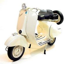 Cream Vespa.  I'd be too scared to drive it anywhere but like Seaside, FL or something.