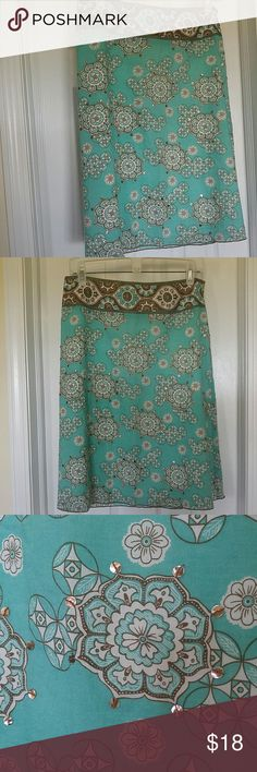 BEAUTIFUL SUMMER SKIRT This New York & Co skirt is the perfect addition to your wardrobe. The turquoise green color is so pretty & fun with just a touch of sparkle with the outline sequins. The brown waistband just lays perfectly on the hips...not really a low waistband but just the way it snugs the waist/hips. New York & Company Skirts Midi