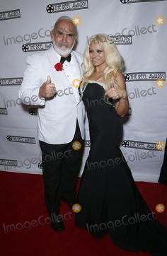 22 February 2016 - Las Vegas, Nevada - Dennis Keogh as Sean Connery, Ana Lopez as Pamela Anderson.  Red Carpet Arrivals at the 2015 Reel Awards at The Golden Nugget Hotel and Casino. Photo Credit: MJT/AdMedia