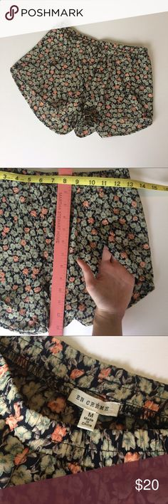 """Floral Tulip swing shorts M """"Flower pattern shorts with side slits that make moving around in the summer easy breezy. The pattern is an orange and green with a black background.   Polyester Medium, with elastic waistband so could fit a small or large Like new condition"""" Shorts"""