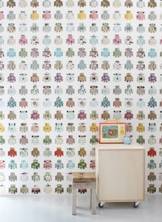 Robot wallpaper for your nursery or kid's room with an almost floral vintage feel. Odd but good odd.