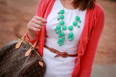 white dress, orange cardigan, turquoise necklace