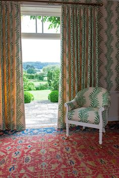 Soane Britain's spring 2017 designs include The Spoonbill Chair upholstered in Scrolling Fern Frond in emerald with matching wallpaper and curtains shown here. Matching Wallpaper And Curtains, Fabric Wallpaper, Luminaire Mural, Interior Design Boards, 2017 Design, Upholstered Chairs, Coastal Living, Colorful Decor, Furniture Making