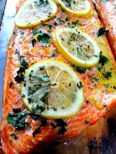 Cedar Plank grilled salmon brushed with olive oil, finely smashed garlic, salt, pepper, lemon zest, lemon slices and chopped fresh parsley. Soak your planks for a few ...