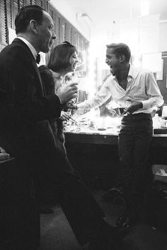 Frank Sinatra, Natalie Wood and Sammy Davis Jr. backstage during Davis' concert, photographed by John Dominis, 1965.