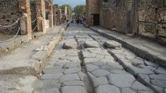 A street in Pompeii. What are those ruts in the road? What were they used for?