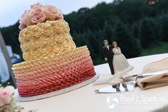 A look at the wedding cake featured at Justin and Lauryn's July 2016 wedding reception at the Overlook at Geer Tree Farm in Griswold, Connecticut.To see more photos from Justin and Lauryn's wedding, please visit http:// www.tinyurl.com/JustinAndLauryn (Copyright 2016: Paul J. Spetrini Photography)