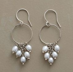 "Palest gray cultured pearls dance from graduated links on slender hoops of sterling silver. Handmade in USA exclusively for us. 1-5/8""L."
