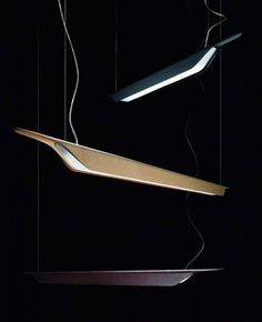 The Troag Suspension Lamp has been designed by Luca Nichetto in 2010 and is made in Italy by Foscarini. The design of this simple and elegant fixture resembles a swedish troag, a canoe shaped wooden bowl used for crushing fruit. The simplicity of the design allows for a fitting application in either the home or office. The heat-curved wood is especially milled to create a dynamic profile.