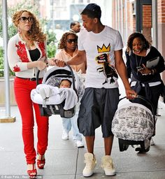 Nick Cannon was seen dressed in an outfit much younger than his years as he stepped out with Mariah Carey and their children yesterday.      Read more: http://www.bellenews.com/2012/04/16/entertainment/mariah-carey-and-nick-cannon-stepped-out-with-monroe-and-moroccan/#ixzz1sF6jEhoB