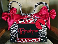 A personal favorite from my Etsy shop https://www.etsy.com/listing/84055244/3d-red-fur-lady-bug-diaper-bag-black-n