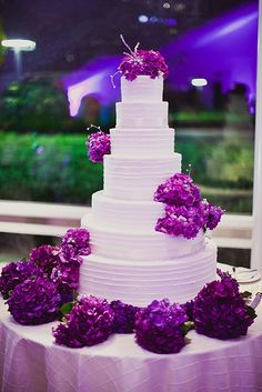 -Gorgeous wedding cake with purple accenst.<3