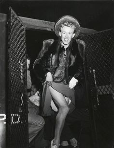 Weegee, Man arrested for cross-dressing, New York, 1939