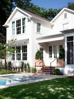 White and Black house with Striped Awning