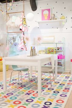 Loving the pops of fun color in this room, but still enough white space that it doesn't feel chaotic.