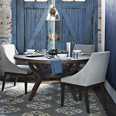 Love the blue barn doors (a folding screen or shutters could give a similar effect) - Arc Base Pedestal Table at westelm.com