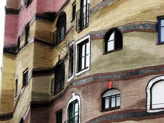 https://flic.kr/p/4yjL5h | trees growing out of windows | The windows of the Waldspirale, which number over 1000, are all unique: no two windows are the same. Similarly, different handles are attached in each apartment to the doors and windows.
