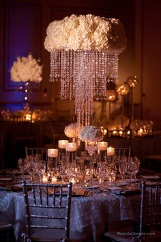 Centerpiece idea with white hydrangeas and crystal chandelier.