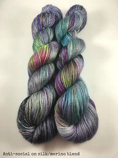 Anti-Social dark jewel tones with subtle splashes of color. Main color is purples and steel blues. pre-orders 5 bases available *shown in image is silk/merino base BASES Worsted-100% SW Merino Wool 218y/100gr DK-100% SW Merino Wool 231y/100gr Fingering-75/25% SW Merino/Nylon-463y/100gr Sparkle Sock-75/20/5% SW Merino Wool/Nylon/Stellina-438y/100gr Sock weight 70/30% SW Merino/silk 438y/100gr