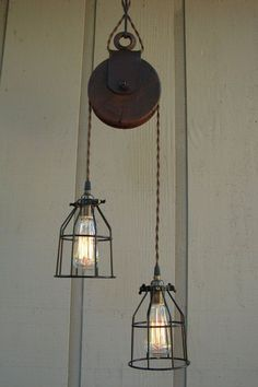 RESERVED for Diane/Upcycled Farm Pulley Lighting Pendant with Bulb Cages. $200.00, via Etsy.