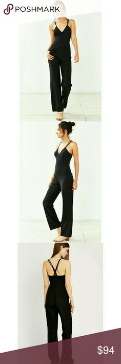 NEW Alice & UO Barbara Deep V Jumpsuit NEW! (NO paper tag plastic piece ONLY) Alice & UO Barbara Deep V Jumpsuit Size 6 Strappy, Black, & Flowy - Beautiful! SOLD OUT! HTF  Pictures do NOT do this jumpsuit justice!  Adjustable straps in the back Zipper with hook closure on the side Hidden pockets on the seems Has rubber no slip type trimming inside to keep it in place. Makes your bust look Great!  *Inside tag will be marked through to prevent returns*  TRADE value is retail* Alice & UO Pants…
