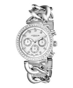 With sleek silver-tone design and a chronograph dial, this wristwatch doesn't have to work around the clock to stay on trend. Brilliant crystals shimmer along the face, while an elegant chain link bracelet completes the look with modern appeal.