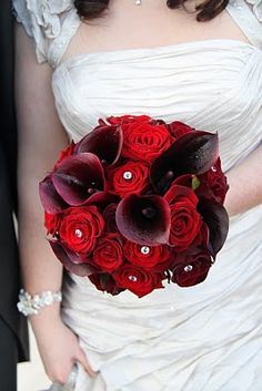 The very luscious deep red and burgundy Wedding Bouquet of Grand Prix Roses, Black baccar Roses and Black calla Lilies