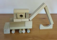 Build a tractor from wooden blocks. Easy instructions, can be built in minutes. Simple enough for preschooler. Boys will love this building block project. Math Blocks, Kids Blocks, Wooden Buildings, Unique Buildings, Wooden Building Blocks, Wooden Blocks, Block Play, Build Something, Creative Activities