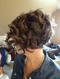 Cute asymmetrical bob for curly hair