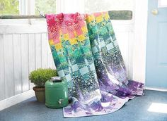 Ikat Quilt Kit by Tula Pink - Inspired by the vibrant Ikat prints found all over India, this modern quilt design mimics this dynamic dyeing method with a soft color gradation created in Tula's rich Eden fabric line.