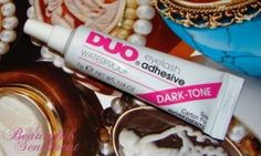 Duo Lash Glue in Dark/Black is great if you are wearing dark liner or eyeshadow! must have for sure=)! can't live without it.