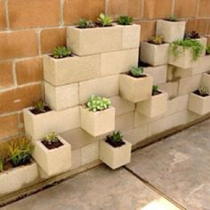 I love this simple idea made with cinder blocks. You could do a moss paint on them so they get covered in moss. Pretty.