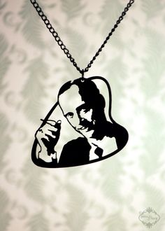 John Waters tribute necklace, portrait pendant in black stainless steel - cult movie jewelry, pink flamingos, geekery necklace by FableAndFury on Etsy https://www.etsy.com/listing/78735781/john-waters-tribute-necklace-portrait