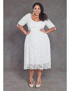 3ddfc907062 This semi-formal plus size stretch dress has a fitted bodice and sleeve. Be