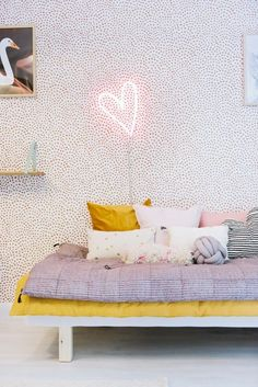 The heart light is perfectly offset by the mustard accents and amazing geometric wall paper. Love this!  #estella #kids #decor